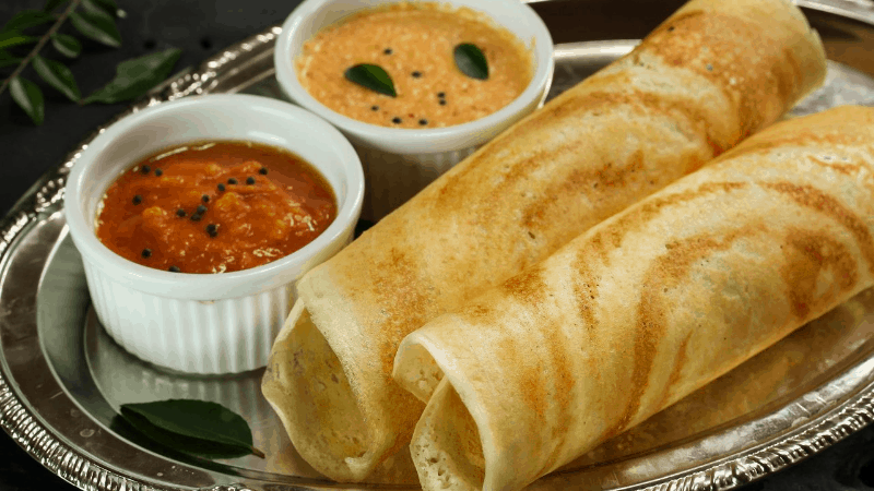 Two dosas with dal onthe side