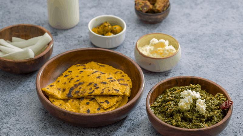Makki ki roti breads, with sarson ka saag on the side.. Famous indian foods.