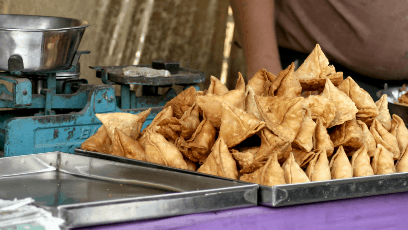 Samosas on a tray, famous Indian snacks