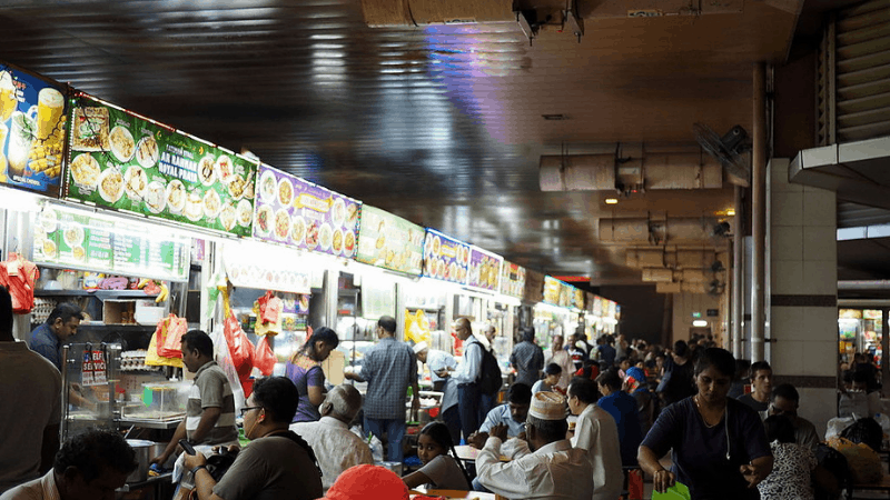 Tekka Centre hawker booths and customers at tables