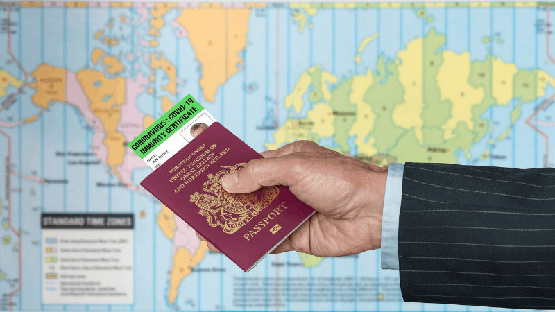 hand holding a passport with a covid certificate inside it. map in background