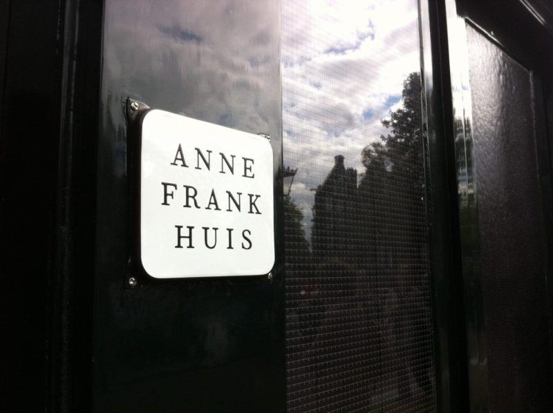 closeup of sign on the front of the Anne Frank building. It says Anne Frank Huis