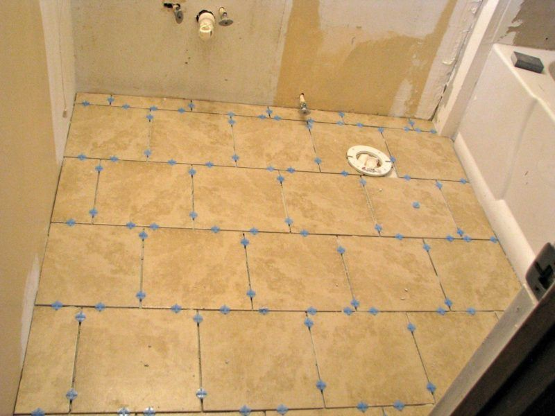 tiles on the floor of the bathroom waiting for the grout