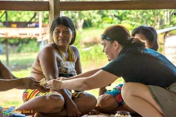 Linda buys a basket in an Embera Indian village