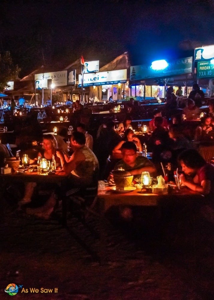 View of candlelit tables when looking back toward Jimbaran warungs