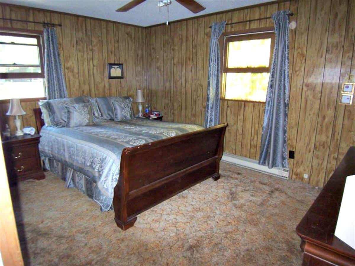 Master bedroom with fake wood paneling, circa 1975
