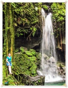 Linda stands beside the waterfall at Emerald Pool Dominica