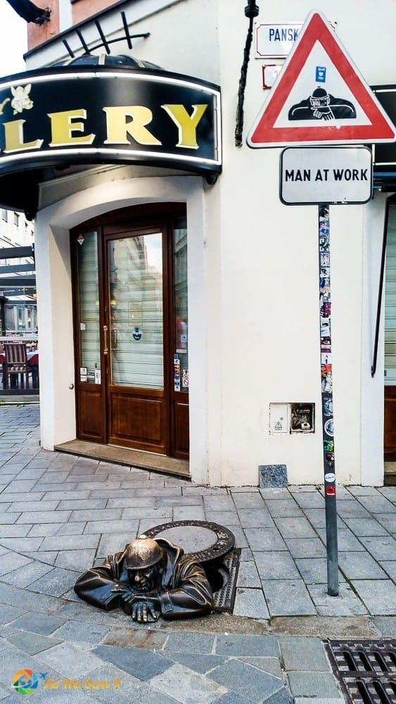 Statue of man in manhole in Bratislava