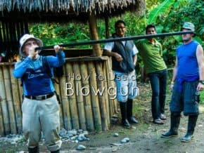 Roger tries his hand at blowing a dart gun