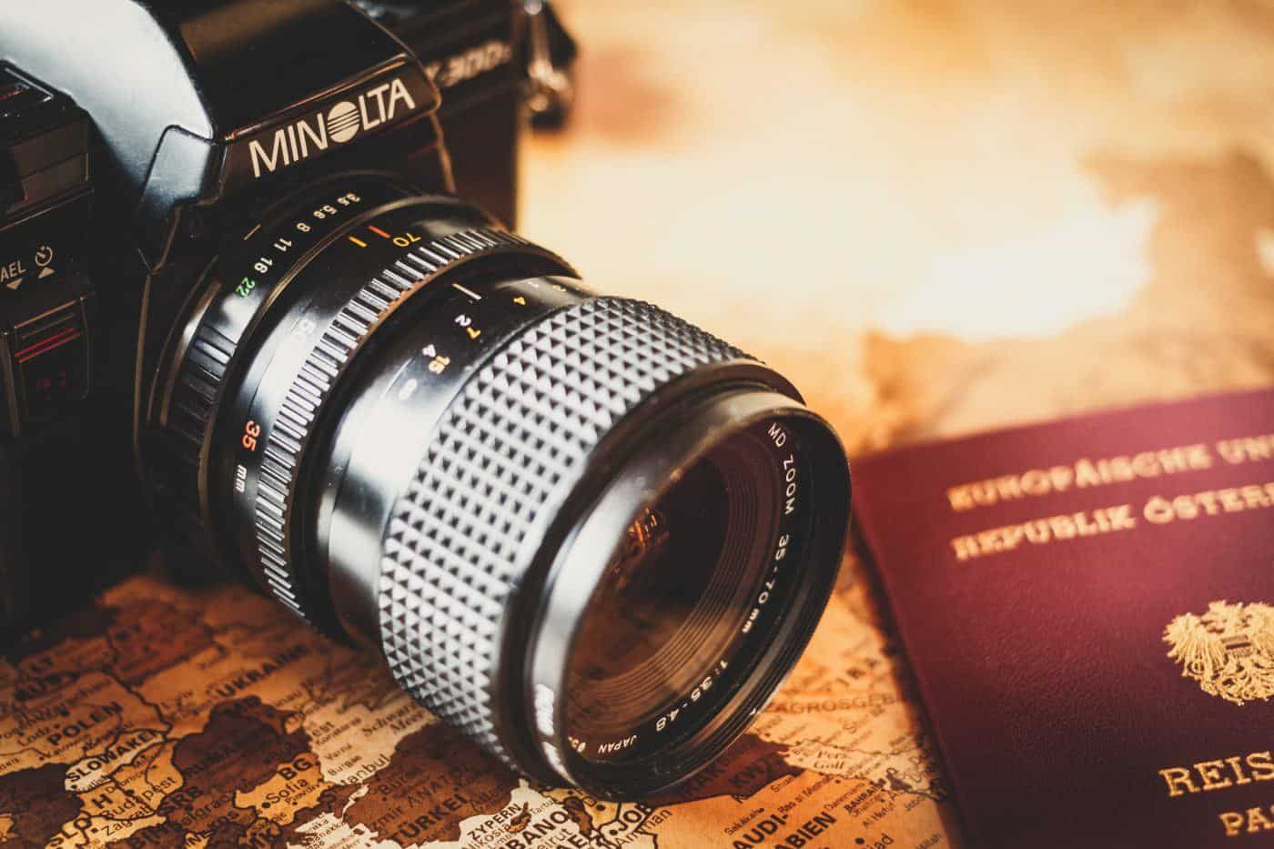 passport and camera for travel blog
